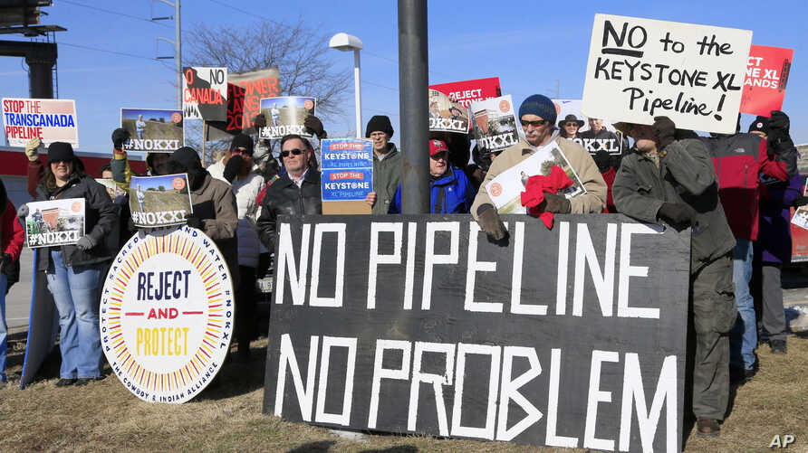 Demonstrators opposing the Keystone XL oil pipeline hold banners in Omaha, Neb., Jan. 13, 2015. Democrats hope to use Senate consideration of the oil pipeline to get Republicans on the record about climate change and resurrect parts of a bipartisan e...