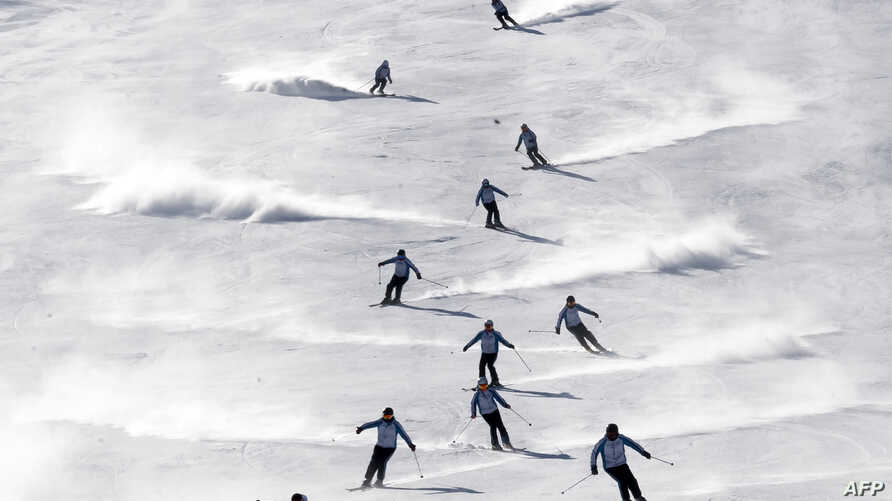 North and South Korean skiers take part in a joint training session at the Masikryong ski resort, near North Korea's east coast port city of Wonsan on February 1, 2018.