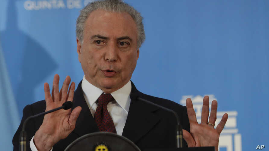 Brazil's President Michel Temer talks to press during a joint news conference at the government's official residence in Buenos Aires, Argentina, Oct. 3, 2016.