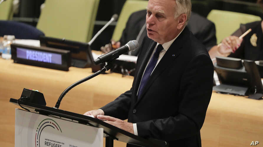 Jean-Marc Ayrault, minister for Foreign Affairs for France, speaks during a meeting addressing actions and cooperation on the large movement of refugees and migrants, Monday, Sept. 19, 2016, at U.N. headquarters.