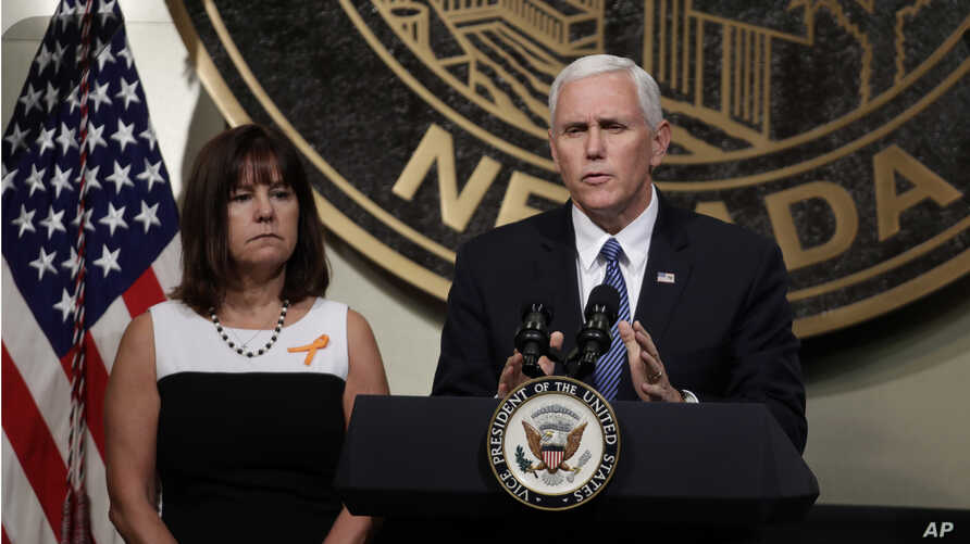 Vice President Mike Pence, accompanied his wife, Karen, speaks in Las Vegas, Oct. 7, 2017, following a unity prayer walk honoring the victims of last weekend's massacre.