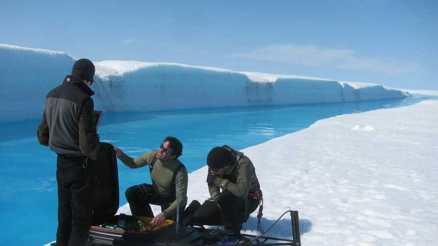 Meltwater drains from Greenland's ice sheet at such a fast rate that researchers couldn't risk entering the water to get readings so they used a remote-controlled drone boat.  (UCLA/ Laurence C. Smith)