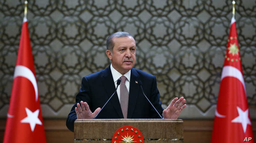FILE - Turkish President Recep Tayyip Erdogan speaks to local administrators at his palace in Ankara, Turkey, Nov. 26, 2015. He voiced regret Nov. 28 about Turkey's downing of a Russian warplane.