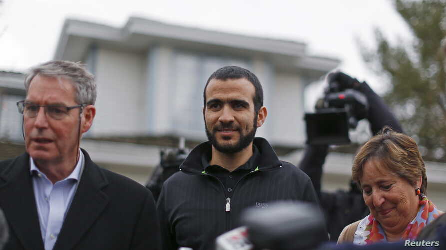 FILE - Lawyer Dennis Edney (left), client Omar Khadr and Patricia Edney meet the media outside their house where Khadr will stay after being released on bail in Edmonton, Alberta, May 7, 2015. Khadr, a Canadian, was once the youngest prisoner held on
