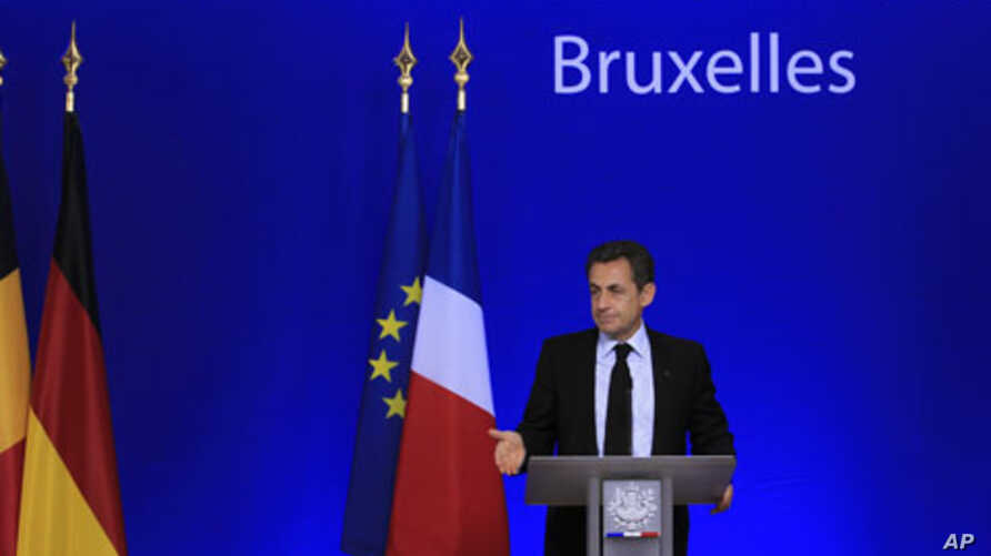 France's President Nicolas Sarkozy holds a news conference at the end of a Euro zone summit in Brussels, October 27, 2011.