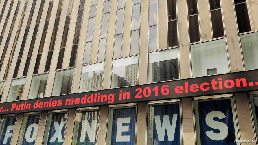A news ticker displays headlines from the meeting of U.S. President Donald Trump and Russia's President Vladimir Putin in Helsinki, Finland on the News Corp building in New York, July 16, 2018.
