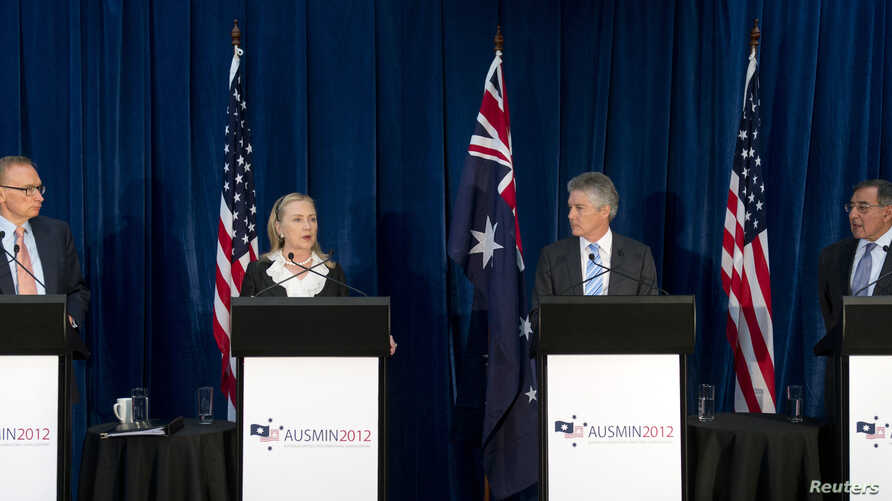 Australian Foreign Minister Bob Carr, U.S. Secretary of State Hillary Clinton, Australian Defense Minister Stephen Smith and U.S. Defense Secretary Leon Panetta (L-R) hold a news conference at the State Reception Centre in Kings Park in Perth, Novemb
