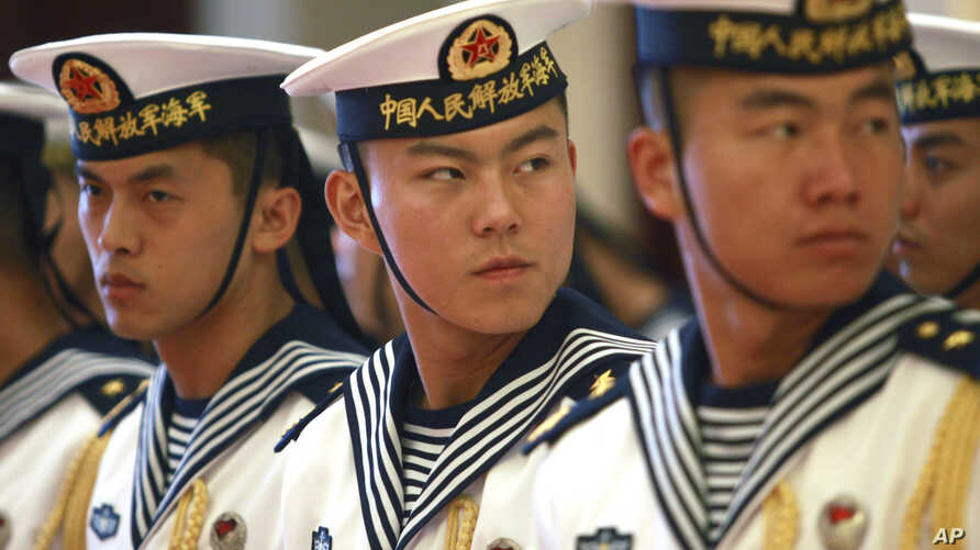 FILE - A military honor guard prepares for U.S. Chief of Naval Operations Admiral Jonathan Greenert's visit with Commander in Chief of the PLA Navy Adm. Wu Shengli at a welcoming ceremony at the PLA Navy headquarters outside Beijing, China, July 15,