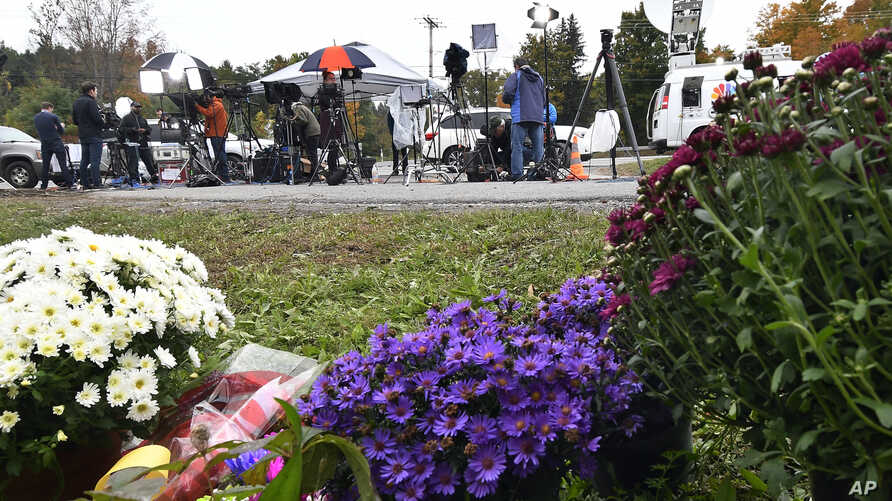 Television networks broadcast at the roadside memorial scene of Saturday's fatal limousine crash in Schoharie, New York, Oct. 8, 2018.