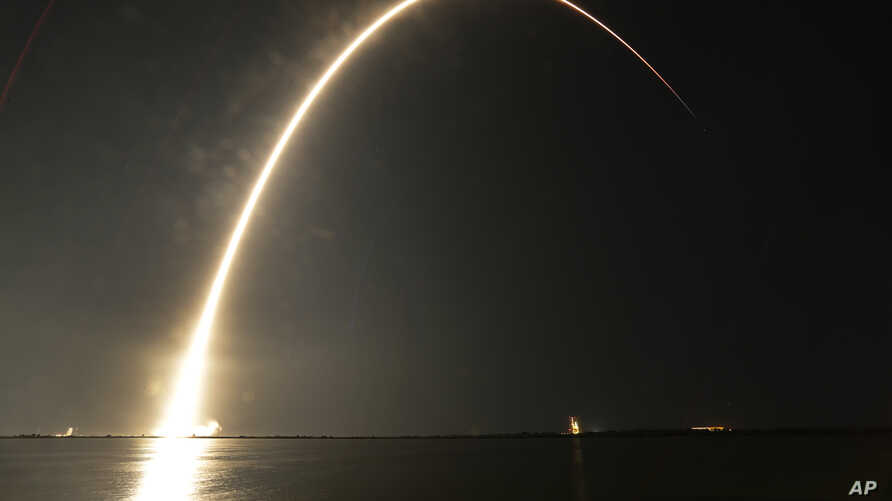 A Falcon 9 SpaceX rocket lifts off from the Cape Canaveral Air Force Station Complex 40 launch pad as seen through a time exposure in Cape Canaveral, Florida, Aug. 7, 2018.
