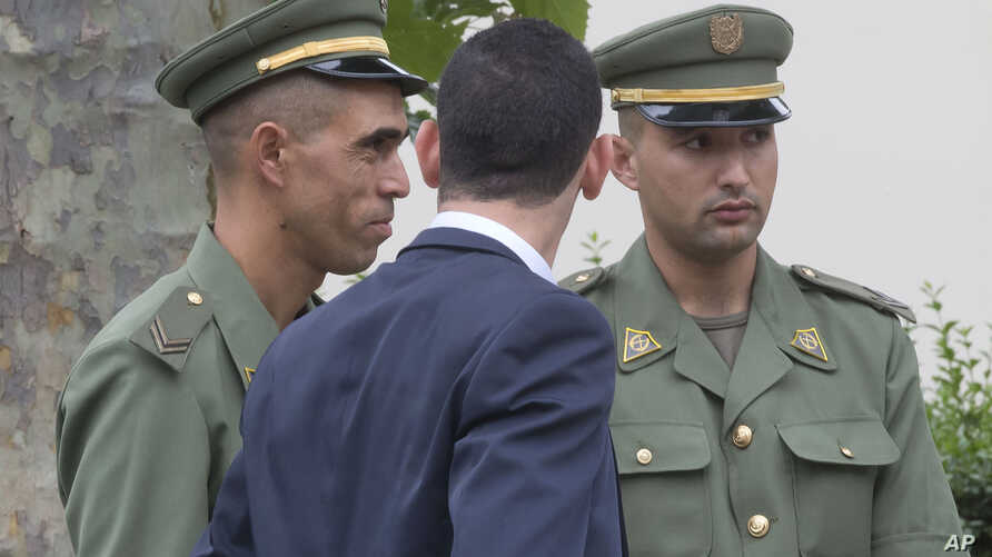 Algerian soldiers attend a welcome ceremony with other foreign soldiers from 80 nations that fought for France in World War I, and descendants of veterans in Paris, July 7, 2014.