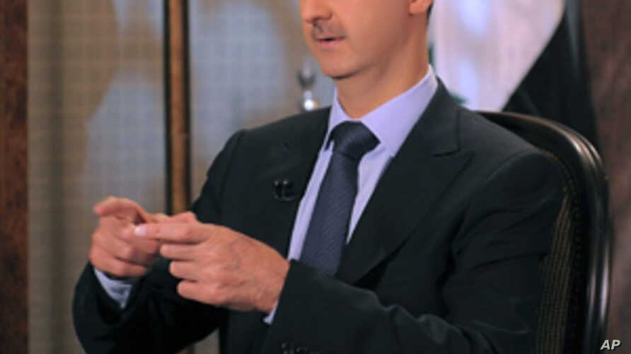 Syria's President Bashar  al-Assad speaks during an interview with Syrian state television, Damascus, August 21, 2011.