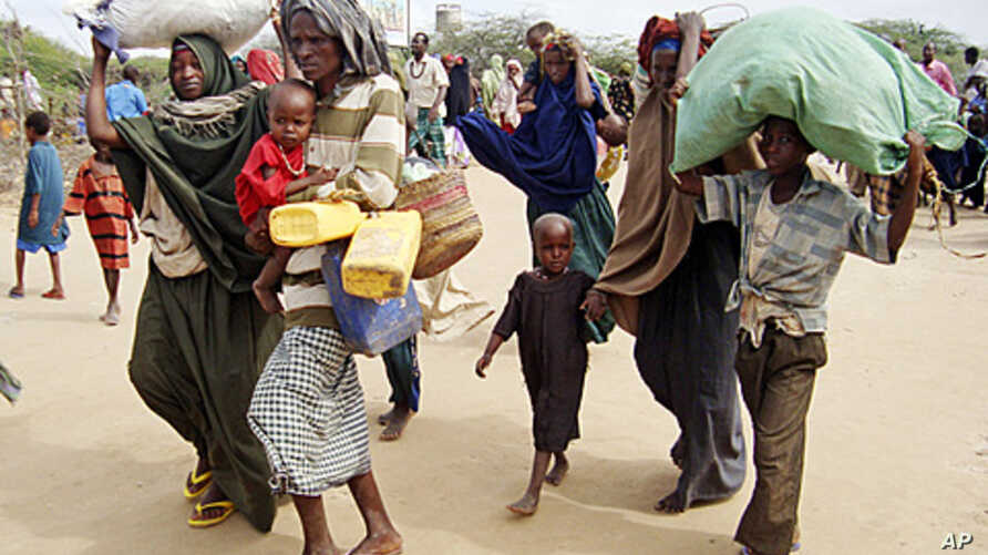 A Somali family  from southern Somalia, after traveling 500kms, arrive at a refugee camp  in Mogadishu, Somalia, July 16, 2011