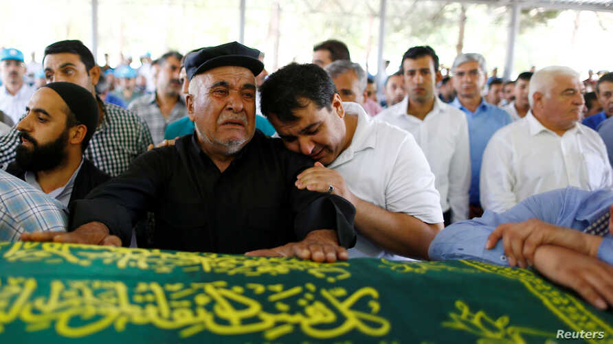 Relatives of Kumri Ilter, one of the victims of Saturday's suicide bombing at a wedding, mourn during her funeral ceremony in southeastern city of Gaziantep, Turkey, Aug. 22, 2016.