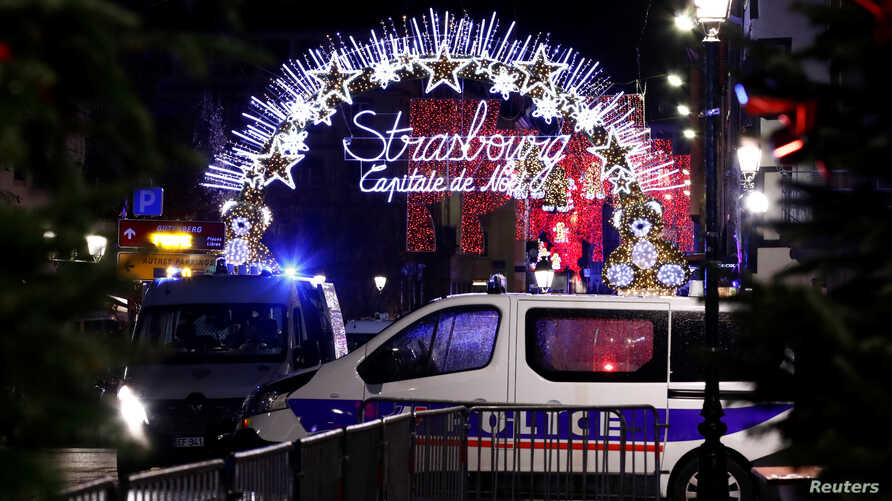 Police secures area where a suspect is sought after a shooting in Strasbourg, France, Dec. 11, 2018.