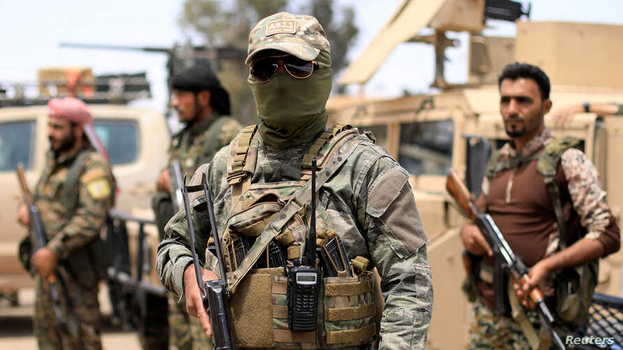 Fighters of Syrian Democratic Forces (SDF) are seen in Deir al-Zour, Syria, May 1, 2018.