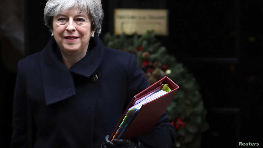 Britain's Prime Minister Theresa May leaves 10 Downing Street in London, Dec. 13, 2017.