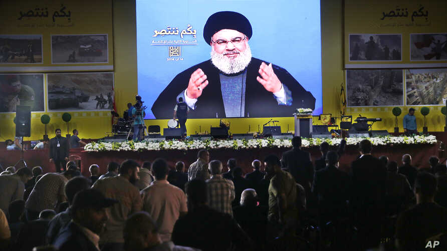 Hezbollah leader Sayyed Hassan Nasrallah delivers a broadcast speech through a giant screen, during a rally marking the12th anniversary of the 2006 Israel-Hezbollah war, in Beirut, Lebanon, Aug. 14, 2018.