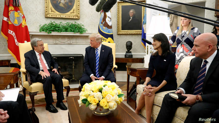 U.S. President Donald Trump, flanked by U.S. Ambassador to the United Nations Nikki Haley (2nd R) and National Security Adviser H.R. McMaster (R), delivers remarks to reporters as he welcomes United Nations Secretary General Antonio Guterres (L) for