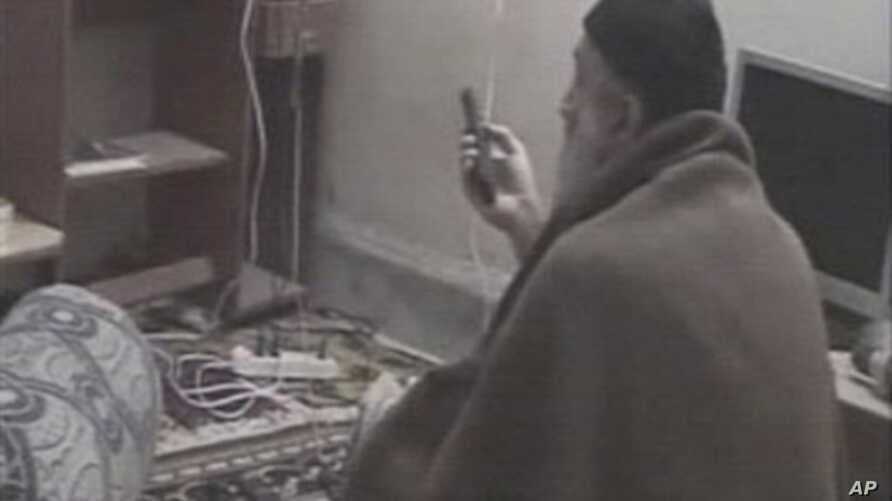 In this undated image taken from video provided by the U.S. Department of Defense, a man who the American government says is Osama bin Laden watches television in a video released on May 7, 2011