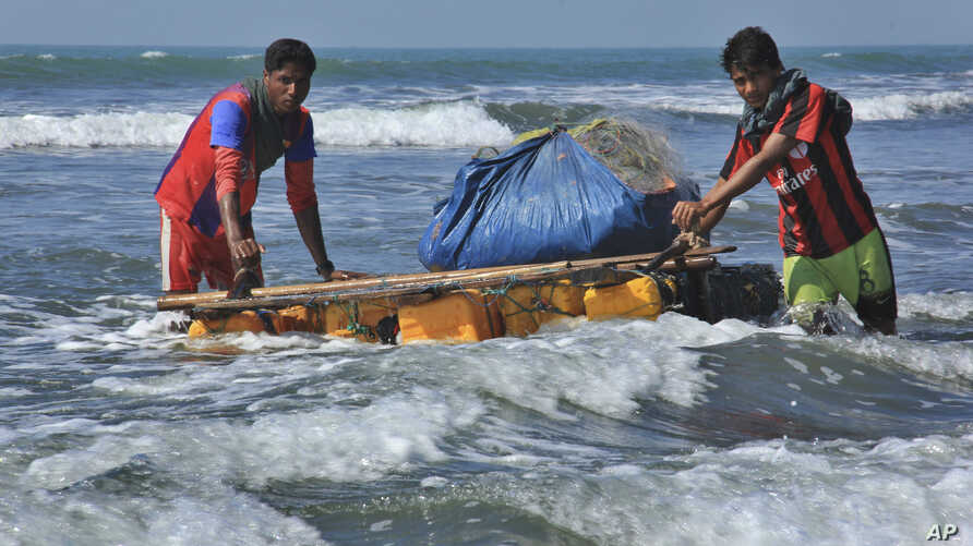 Banned From Boats in Myanmar, Rohingya Fish on Rafts of Junk