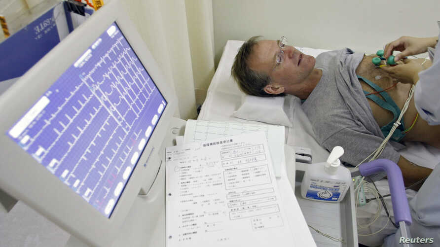FILE - A stroke patient undergoes an electrocardiogram while recovering at Juntendo University Hospital in Tokyo.