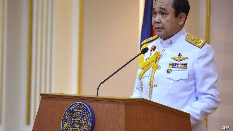 In this photo released by Thai Spokesman Office, Gen. Prayuth Chan-ocha speaks  after he accepted a written royal command issued by King Bhumibol Adulyadej certifying his appointment as the country's 29th premier in Bangkok in Bangkok, Thailand Monda