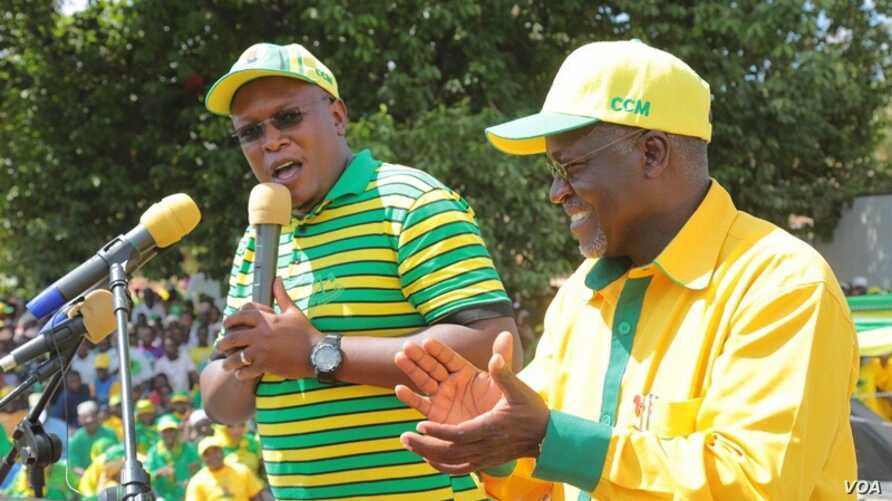 Nape Nnauye, spokesman for the ruling Chama Cha Mapinduzi (CCM) party, speaks alongside President-elect John Magufuli. (Credit: Nape Nnauye)