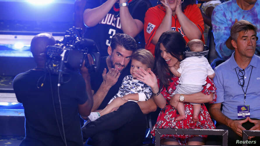 FILE - Michael Phelps and family attend the Kids Choice Sports Awards 2018 show in Los Angeles, CA, June 19, 2018.