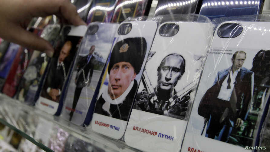 Mobile phones cases displaying images of Russian President Vladimir Putin are displayed at an electronic store in Stavropol in southern Russia, February 12, 2015.