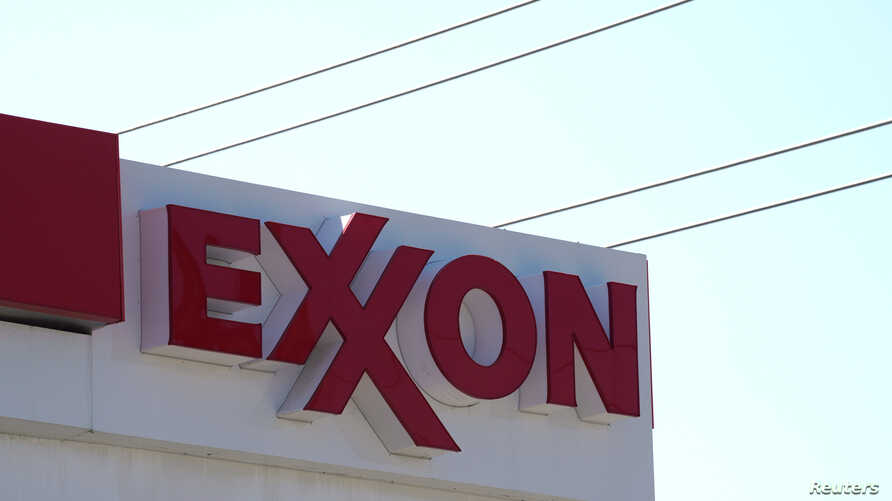 FILE - The Exxon Mobil logo is shown at a gas station in Denver, Colorado, US.