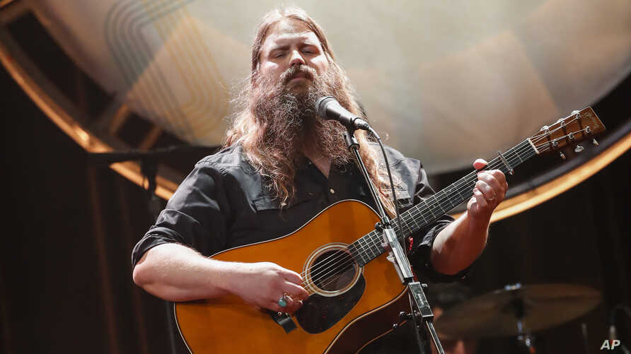 FILE - In this Aug. 22, 2018, file photo, Chris Stapleton performs at the 12th Annual ACM Honors at the Ryman Auditorium in Nashville, Tenn. Stapleton tops the list of finalists with five nominations for the 52nd annual Country Music Association Awar