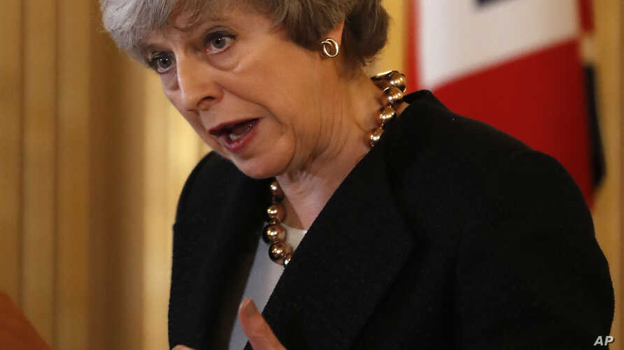 Britain's Prime Minister Theresa May speaks to the media during a press conference with Polish Prime Minister Mateusz Morawiecki following a UK/Poland IGC meeting in London, Dec. 20, 2018.