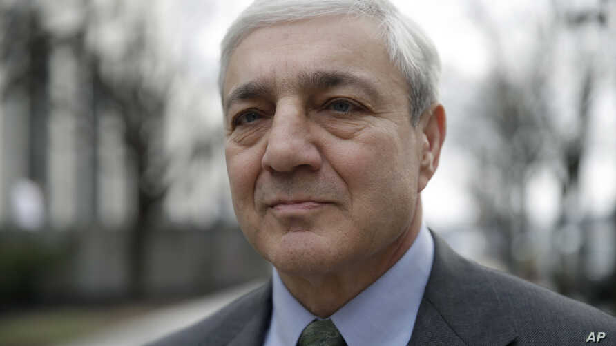 Former Penn State president Graham Spanier walks from the Dauphin County Courthouse in Harrisburg, Pa., March 24, 2017.