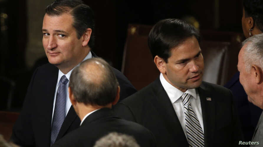 FILE - Republican Senators Ted Cruz and Marco Rubio are seen in the House of Representatives Chamber of the US Capitol after Pope Francis' address Sept. 24, 2015.