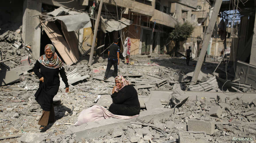 Reconstruction in Gaza, where heavy Israeli bombardment in a war with Islamist militants has caused widespread devastation and displaced half a million people, will cost at least $6 billion, the Palestinian deputy prime minister says. A Palestinian w