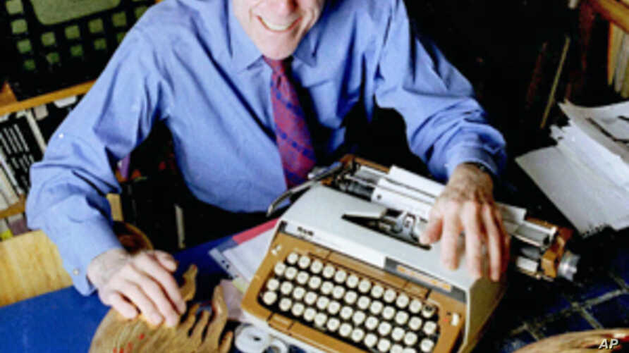 In this file photo from 1998, publisher Barney Rosset poses with some of his favorite things in his New York loft. Rosset died Tuesday, Feb. 21, 2012 in New York.