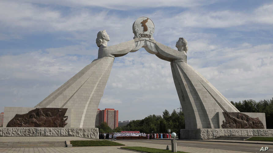 FILE - The Arch of Reunification, a monument to symbolize the hope for eventual reunification of the two Koreas, pictured in Pyongyang, North Korea, Sept, 11 ,2018. South Korean President Moon Jae-in is pushing hard to link the roads and railways of