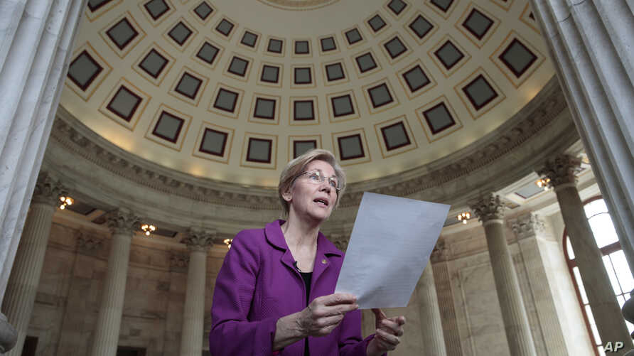 Holding a transcript of her speech in the Senate Chamber, Sen. Elizabeth Warren reacts to being rebuked by the Senate leadership and accused of impugning a fellow senator, Attorney General-designate, Sen. Jeff Sessions, Feb. 8, 2017.