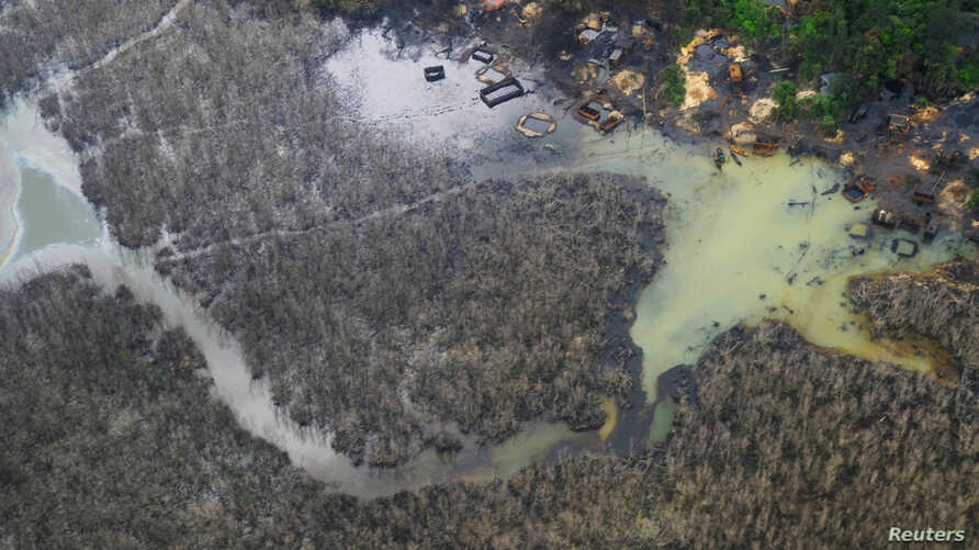 FILE - An aerial view shows illegal refineries and pollution among the waterways in Rivers State, Nigeria, June 19, 2017.