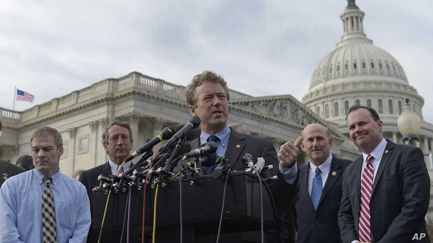 Sen. Rand Paul, R-Ky., center, joined by, from left, Rep. Jim Jordan, R-Ohio, Rep. Mark Sanford, R-S.C., Rep. Louie Gohmert, R-Texas, and Sen. Mike Lee, R-Utah, speaks about health care during a news conference on Capitol Hill in Washington, March 7,