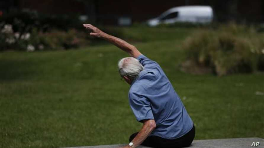 In this Tuesday, June 17, 2014 photo, George Jackson, 85, an army veteran and former boxer participates at a parkour class for elderly people at a park in south London. 'I just sometimes forget how old I am and that I can't do certain things', said J
