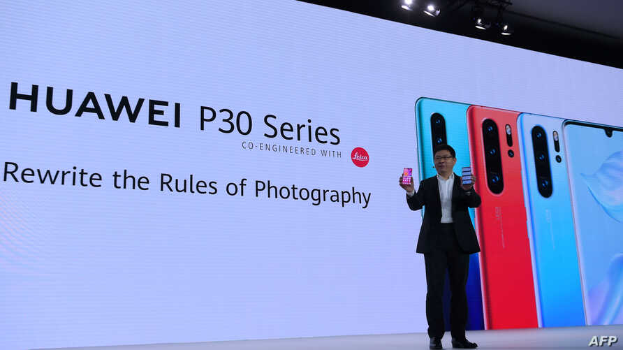 Chinese Telecom equipment company Huawei Consumer Products division CEO Richard Yu gestures as he speaks on stage during the presentation the new P30 smart-phone, in Paris, on March 26, 2019. (Photo by ERIC PIERMONT / AFP)
