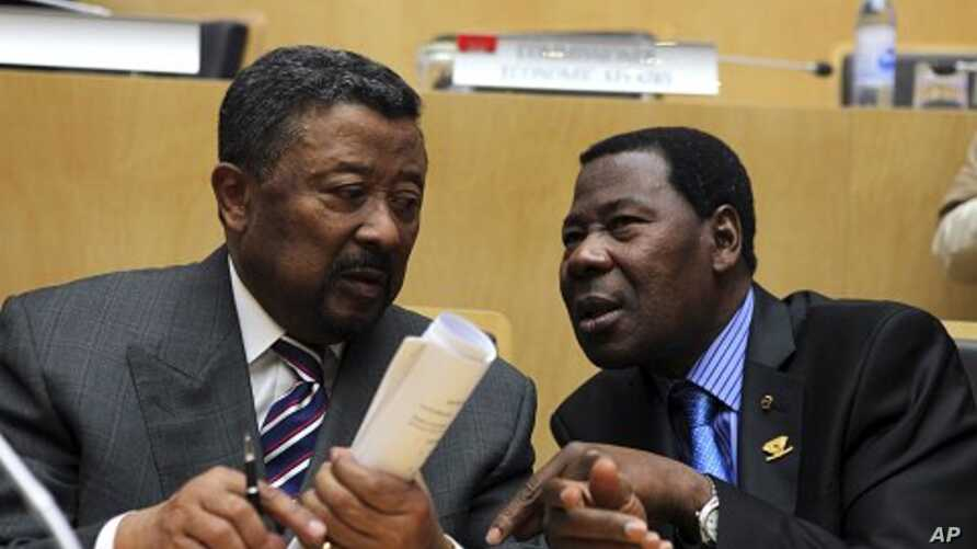 African Union Commission Chairman Jean Ping (L) and Benin's President Thomas Boni Yayi, newly elected African Union president, talk shortly after the closing ceremony of the 18th African Union (AU) summit in Ethiopia's capital Addis Ababa, January 31