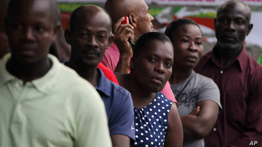 People stand in line to vote during elections in the Petion-Ville suburb of Port-au-Prince, Haiti, Nov. 20, 2016.