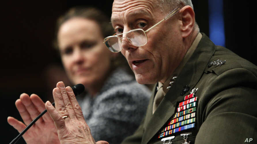 """FILE - Marines Lt. Gen. John Paxton testifies before a Senate committee on Capitol Hill, Feb. 22, 2010. Now a general and the Marines' assistant commandant, Paxton told senators on March 15, 2016, that the Marine Corps """"is no longer in a healthy posi"""