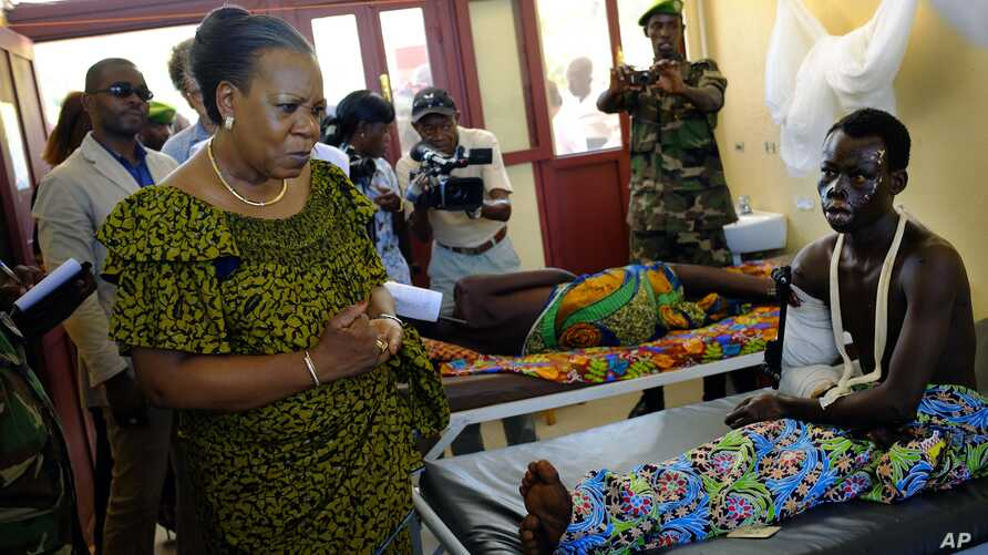 Interim President Catherine Samba-Panza visits victims at the general Hospital in Bangui, Central African Republic, June 1, 2014.