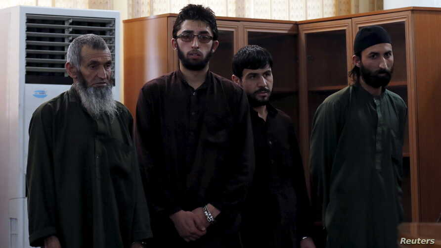 Four Afghan men look on in court during their trial in connection with the killing of a 27-year-old woman, in Kabul, Afghanistan May 6, 2015. An Afghan judge sentenced the four men to death on Wednesday for the mob killing of a 27-year-old woman accu