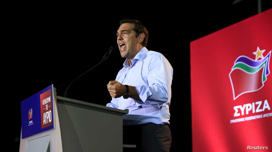 Former Greek Prime Minister and leader of leftist Syriza party Alexis Tsipras delivers a speech during a pre-election rally in the western suburb of Egaleo, in Athens, Greece, Sept. 3, 2015.