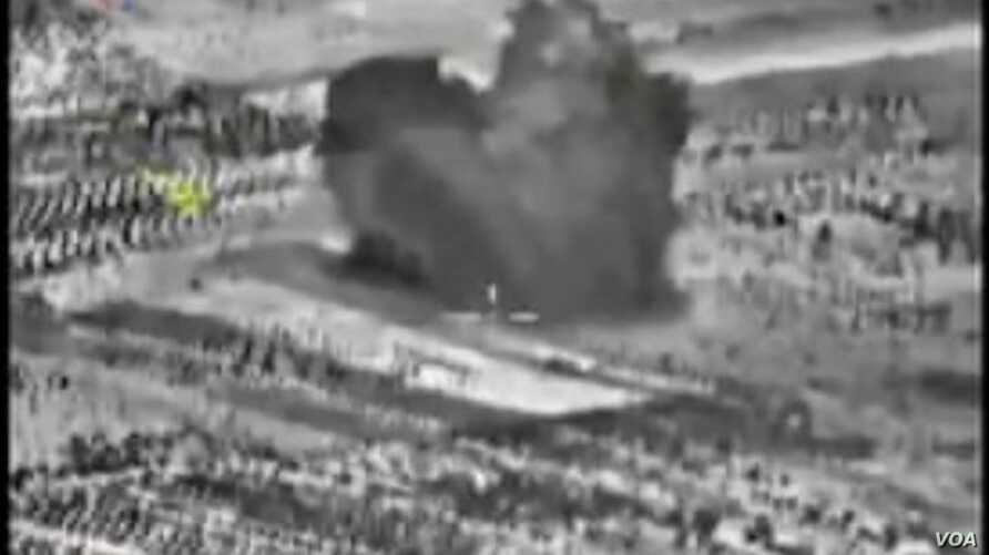 An image taken from footage made available on the Russian Defense Ministry's official website purports to show an explosion after airstrikes carried out by the Russian air force.
